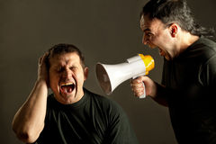 Yelling with a megaphone Stock Photo