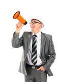 Yelling through a megaphone. Business man yelling through a megaphone on white background Royalty Free Stock Image