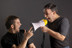 Yelling with a megaphone Royalty Free Stock Images