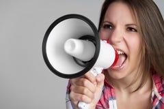 Yelling Megaphone Woman. Beautiful young yelling megaphone woman Royalty Free Stock Photos