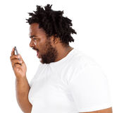 Yelling Into Phone Stock Image