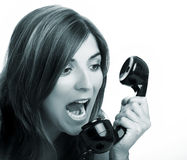 Yelling at the phone Royalty Free Stock Photos