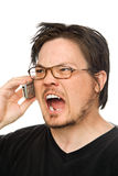Yelling at the phone. A man using a cell phone on a white background stock photo