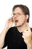 Yelling at the phone. A man using a cell phone on a white background stock image