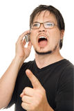 Yelling at the phone. A man using a cell phone on a white background stock images