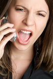 Yelling Phone Woman. Angry yelling cell phone woman Royalty Free Stock Image