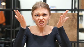 Yelling, Screaming Angry Young Girl in Office Stock Photography