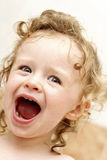 Yelling toddler in the bath. Room, spontaneous face expression Stock Image