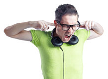 Yelling young man with headphones and black glasses. Young man with headphones and black glasses yelling with eyes closed isolated on white background Stock Photo