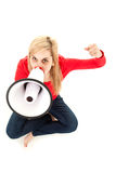Yelling young woman with megaphone Stock Image