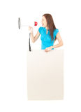 Yelling young woman, megaphone and empty poster Royalty Free Stock Photos