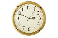 Yelloish round clock. Isolated on white Stock Images
