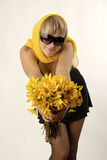 Yellow. There is women with yellow flowers looks at you stock images