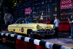 Yellow 1953 Lincoln Capri starts the 1000 Miglia Royalty Free Stock Photo