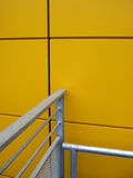 Yellow. Wall and metal stock image