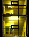 Yellow. Upright shot of a yellow lit corridor or hallway of a modern building at night Stock Photo