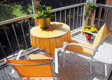 Yellow table and chairs. Round table and two chairs on a patio in South Florida Stock Image