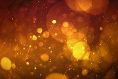 Yellow abstract background with bokeh defocused lights Stock Images