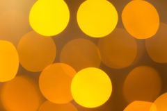 Yellow abstract bokeh background. Christmas lights texture background royalty free stock photo