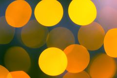 Yellow abstract bokeh background. Christmas lights texture background stock photo