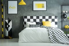 Free Yellow Accent In Dark Bedroom Stock Images - 100831274