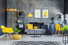Yellow accents and metal furniture. Creative office interior with gray couch, yellow accents and metal furniture Royalty Free Stock Photos