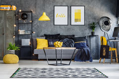 Yellow accents in teenager`s room. Optimistic teenager`s room with gray wall, furniture and yellow accents Stock Images