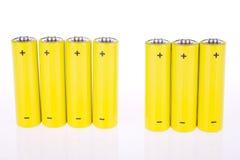 Yellow accumulators. Under the white background Stock Photo