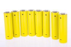 Yellow accumulators. Under the white background Stock Photos