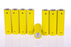 Yellow accumulators. Under the white background Royalty Free Stock Photos