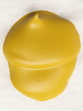 Yellow acorn. Drop embossed yellow acrylic paint, which took the form of an acorn Stock Photography