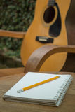 Yellow Acoustic Guitar On Wooden Table Stock Photos