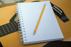 Yellow Acoustic Guitar On Wooden Table Stock Image