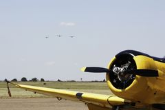 Yellow Acrobatic Harvard Aircraft with Bosbok formation on Approach stock images