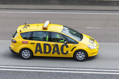 Yellow ADAC Ford S-Max on the highway Stock Photography