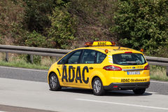 Yellow ADAC Ford S-Max on the highway Stock Image