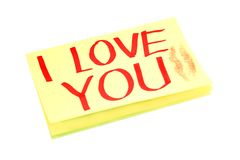Yellow adhesive note. On white background with I LOVE YOU written on,and with print of female's kiss Stock Photo