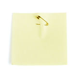 Yellow adhesive note attached  safety pin Royalty Free Stock Photos