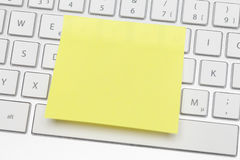 Yellow adhesive note Royalty Free Stock Photo