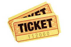 Yellow tickets isolated white background. Pair of yellow admission tickets isolated on a white background Royalty Free Stock Images