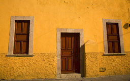 Yellow Adobe House Brown Doors Morelia Mexico. Bright Yellow Adobe House with brown doors Morelia Mexico Royalty Free Stock Photography