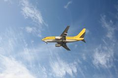 Yellow aeroplane. In a blue sky Royalty Free Stock Images