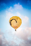 Yellow Air Balloon flying Stock Image