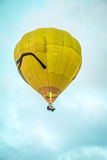 Yellow Air Balloon flying Stock Photography