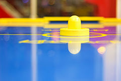 Yellow air hockey mallet Royalty Free Stock Photography