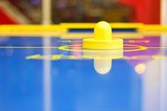 Yellow air hockey mallet