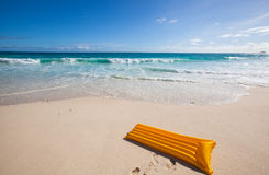 Yellow air mattress at the beach 1 Stock Photography