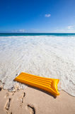 Yellow air mattress at the beach 2 Royalty Free Stock Photography