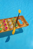 Yellow air mattress with oar in swimming pool Stock Photography