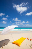 Yellow air mattress and white sunshade Royalty Free Stock Image